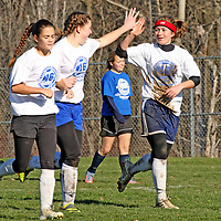 The white teams Libby Harley from Frewsburg high fives Frewsburg's Janessa Annis after Harley scores a goal from the Annis assist during soccer action at Strider Field 11-15-15 photo by Mark L. Anderson