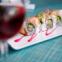 A plate of fresh sushi and a glass of rosé wine at Two Oceans Restaurant located at Cape Point near Cape Town in South Africa.