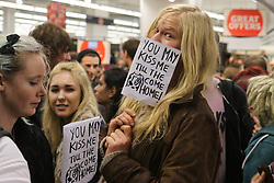 © Licensed to London News Pictures. 15/10/2014. Brighton, UK. Students staging a Kiss In a Sainsbury's New England Street store in Brighton. The event is in protest of the eviction of a Annabelle Paige and her girlfriend from the store for giving each other a kiss. Miss Paige her Student Union called for the Kiss In and urged other groups to join in. The event is hosted by performance artist  Lydia L'Scabies and LUS LGBT Woman's Officer Fran Cowling. Photo credit: Hugo Michiels/LNP