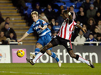 Photo: Leigh Quinnell.<br /> Reading v Southampton. Coca Cola Championship. 10/02/2006. Southamptons Darren Powell can't stop Readings Kevin Doyle having a shot.