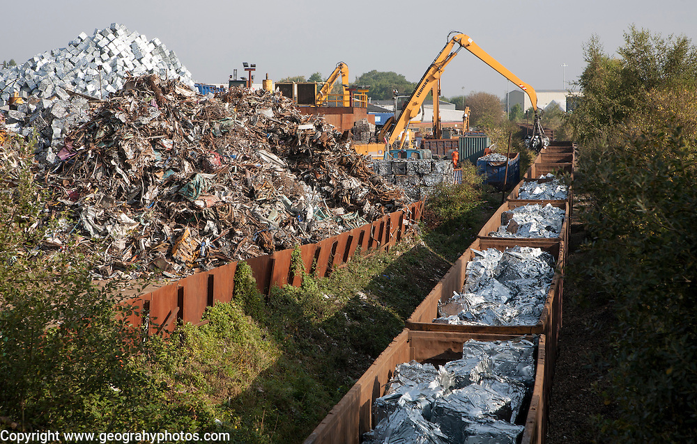 Scrap metal recycling loading train wagons with processed metals, EMR company, Swindon, England, UK
