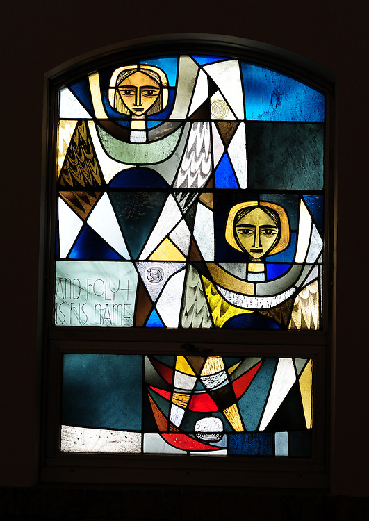 """Stained glass image from Shrine of Our Lady of Good Help in Champion, Wis. """"And Holy Is His Name."""" (Sam Lucero photo)"""