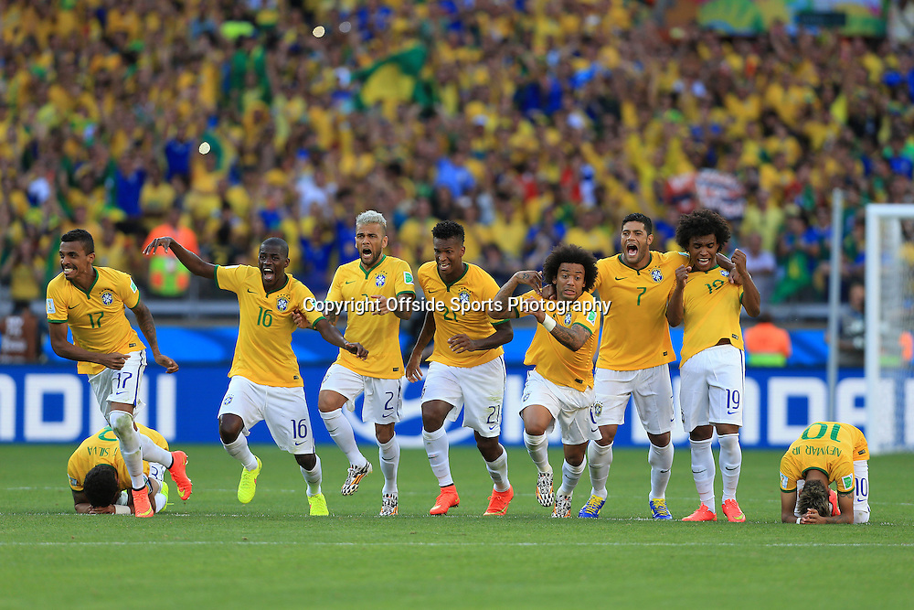 28th June 2014 - FIFA World Cup - Round of 16 - Brazil v Chile - Brazil players celebrate their victory in the shootout - Photo: Simon Stacpoole / Offside.