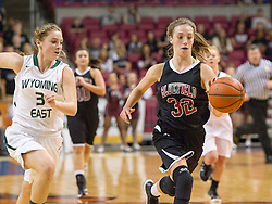 Bluefield center Dani Janutolo (32) dribbles on a break away against Wyoming East during a first round game at the Charleston Civic Center.