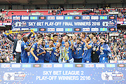 Barry Fuller lifts the trophy. AFC Wimbledon promotion to League One, after beating Plymouth Argyle Football Club 2-0 during the Sky Bet League 2 play off final match between AFC Wimbledon and Plymouth Argyle at Wembley Stadium, London, England on 30 May 2016. Photo by Stuart Butcher.