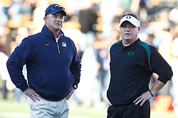 November 13, 2010; Berkeley, CA, USA; California Golden Bears head coach Jeff Tedford (left) and Oregon Ducks head coach Chip Kelly (right) talk at midfield before the game at Memorial Stadium.