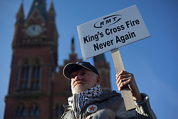 © licensed to London News Pictures. London, UK 18/11/2012. RMT Union members gather outside King's Cross Station to commemorate the 25th anniversary of the fire at King's Cross Underground station, which killed 31 people, and to highlight safety fears. Photo credit: Tolga Akmen/LNP