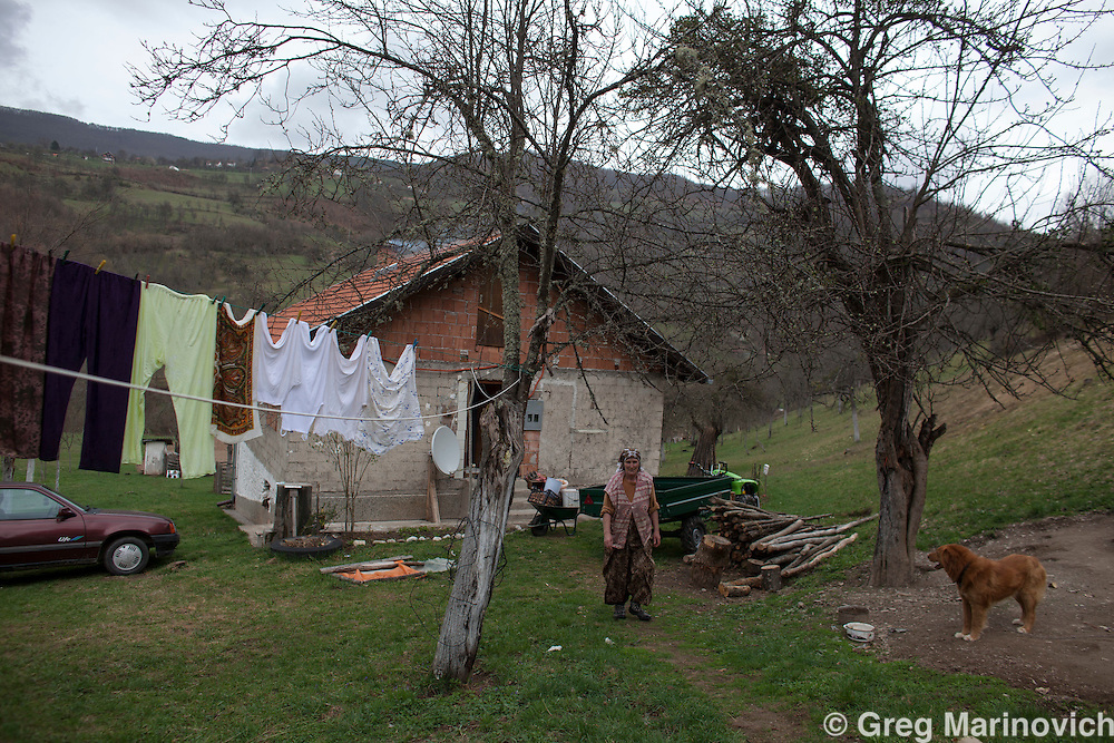 Bosnia and Herzegovina, Republika Srpska, Foca district, April 6, 2012.  Displaced persons Azemina and Murat Subasic, with their daughter-in-law Alena and grandson Edi live in deep poverty near Foca, central BiH. Azemina has cancer breast cancer and other ilnness,a nd continues to need treatment, while her husband's health at 70 years old is also poor. The families only income is a pension of 300 convertible marks (150 EU) and UNHCR donated a culitvator to assit them work their lands to survive.   Greg Marinovich