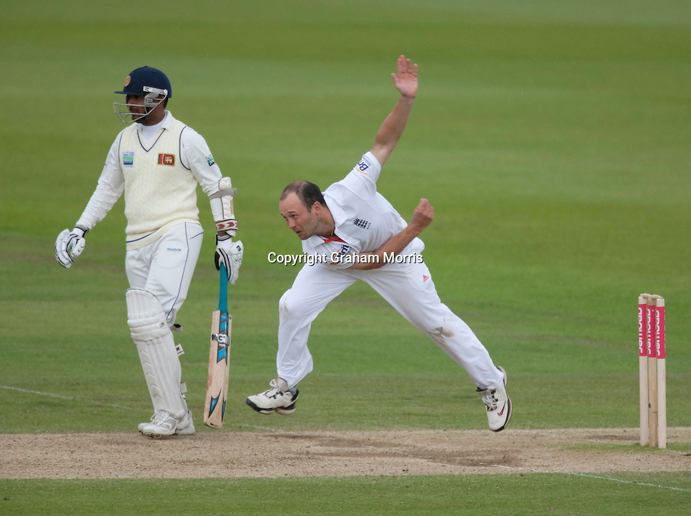 Jonathan Trott bowls past Prasanna Jayawardene during the third npower Test Match between England and Sri Lanka at the Rose Bowl, Southampton.  Photo: Graham Morris (Tel: +44(0)20 8969 4192 Email: sales@cricketpix.com) 20/06/11