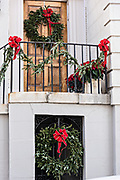 Christmas wreaths decorate a historic home on Water Street in Charleston, SC.