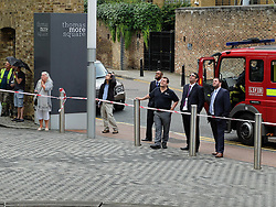 © Licensed to London News Pictures. 22/08/2013. London, UK. Fire Brigade rescue two window cleaners from a cradle which broke down outside the sixth floor at News International's Thomas More offices in London. The motor in the cradle is believed to have broken down and the London Fire Brigade eventually broke an office window to rescue the two men.  Photo credit : Vickie Flores/LNP