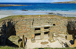 "Skara Brae is a stone-built Neolithic settlement, located on the Bay of Skaill on the west coast of Mainland, the largest island in the Orkney archipelago of Scotland. It consists of eight clustered houses, and was occupied from roughly 3180 BC to2500 BC. Europe's most complete Neolithic village, Skara Brae gained UNESCO World Heritage Site status as one of four sites making up ""The Heart of Neolithic Orkney.""a Older than Stonehenge and the Great Pyramids, it has been called the ""Scottish Pompeii"" because of its excellent preservation.<br /> <br /> (c) Andrew Wilson 