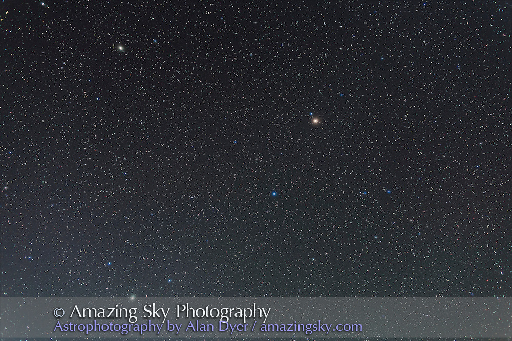 Mars (upper right of centre), Saturn (lower left) and the stars Spica (below reddish Mars) and Arcturus (upper left) in the spring sky, May 3, 2014. <br /> <br /> I shot this May 3, 2014 from the Four Bar Cottages near Portal Arizona using the Canon 6D and 24mm lens for a stack of 4 x 2m15s exposures at f/2.8 and ISO 800 in moonlight from a waxing crescent Moon.