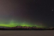 Aurora Borealis over the Chugach Mountains and the Knik River in Southcentral Alaska. Winter. Evening.