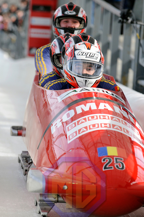 01 March 2009:   The bobsled driven by Nicolae Istrate with sidepushers Ionut Andrei and Mircea Nicolescu Ioan, and brakeman Danut Dovalciuc finish their 4th run at the 4-Man World Championships competition on March 1 at the Olympic Sports Complex in Lake Placid, NY.   The USA 1 bobsled driven by Steven Holcomb with sidepushers Justin Olsen and Steve Mesler, and brakeman Curtis Tomasevicz won the competition and the World Championship bringing the U.S. their first world championship since 1959 with a time of 3:36.61.