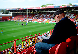 A Bristol Rugby fan reads a programme at their new home,  Ashton Gate - Photo mandatory by-line: Joe Meredith/JMP - Mobile: 07966 386802 - 7/09/14 - SPORT - RUGBY - Bristol - Ashton Gate - Bristol Rugby v Worcester Warriors - The Rugby Championship
