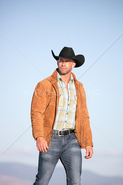 cowboy walking outdoors