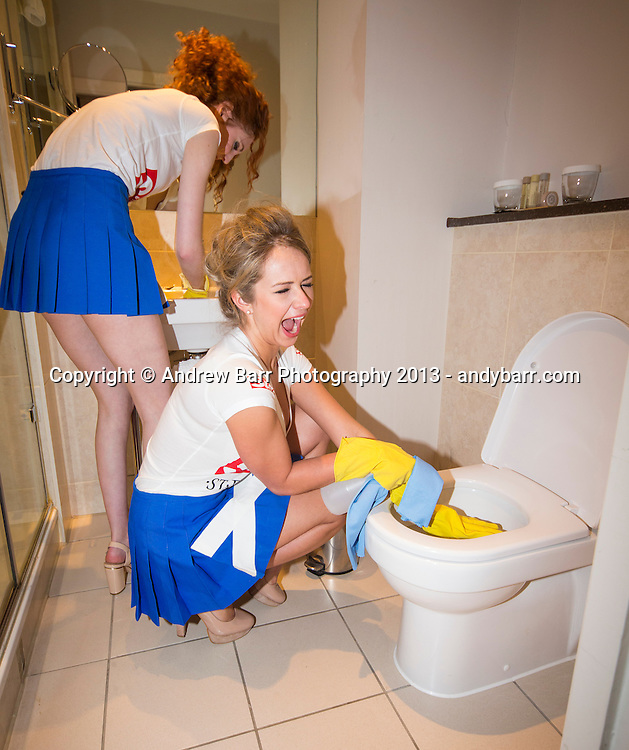02:05:2013..Miss Scotland 2013 - chambermaid challenge at Grand Central Hotel...Monica cleans bathroom with Laura P...Pic:Andy Barr..07974 923919  (mobile).andy_snap@mac.com..All pictures copyright Andrew Barr Photography. ..Please contact before any syndication. .