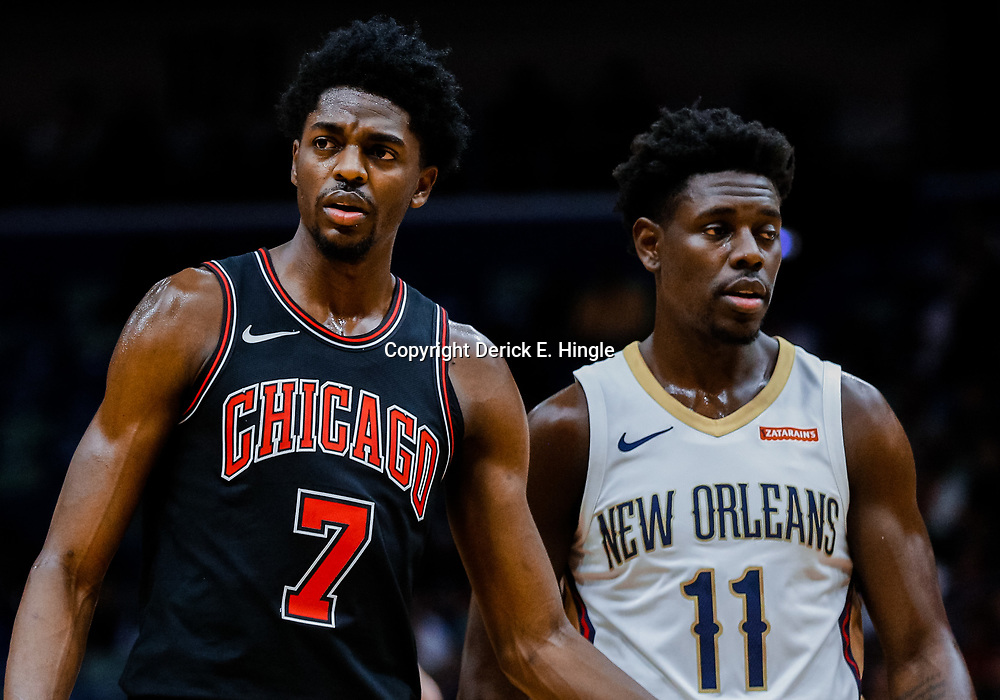 Jan 22, 2018; New Orleans, LA, USA; Chicago Bulls guard Justin Holiday (7) and New Orleans Pelicans guard Jrue Holiday (11) during the first quarter at  the Smoothie King Center. Mandatory Credit: Derick E. Hingle-USA TODAY Sports