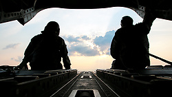 U.S. Army Sgt. 1st Class Roy Chandler, left, and Spc. Benjamin Grogan, assigned to Bravo Company, 1st Battalion, 169th Aviation Regiment, Alabama Army National Guard, sit on the tail of a CH-47 Chinook helicopter in route to deliver hay bales to cattle that have been stranded by Hurricane Harvey near Hampshire, Texas, Sep. 3, 2017. The Department of Defense is conducting Defense Support of Civil Authorities operations in response to the effects of Hurricane Harvey. DSCA operations are part of the DoD's response capability to assist civilian responders in saving lives, relieving human suffering and mitigating property damage in response to a catastrophic disaster. (U.S. Army photo by Spc. Dustin D. Biven)  Please note: Fees charged by the agency are for the agency's services only, and do not, nor are they intended to, convey to the user any ownership of Copyright or License in the material. The agency does not claim any ownership including but not limited to Copyright or License in the attached material. By publishing this material you expressly agree to indemnify and to hold the agency and its directors, shareholders and employees harmless from any loss, claims, damages, demands, expenses (including legal fees), or any causes of action or allegation against the agency arising out of or connected in any way with publication of the material.