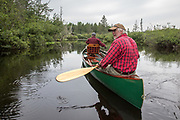 Brule River fishing guide Damian Wilmot  fishes with angler Matson Holbrook in a 1895 Joe Lucius guide canoe Wilmot meticulously restored over the course of two years.