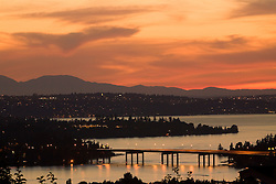 North America, United States, Washington, Lake Washington, Seattle and Olympic Mountains viewed from Bellevue at sunset