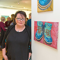 Patricia McGuinness with her portriats 'Boots' at the Art exhibition at the Courthouse Gallery Ennistymon