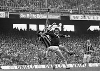 975-207<br /> A Kilkenny defender and Galway forward tussle for a high ball during the All-Ireland hurling final at Croke Park.<br /> (Part of the Independent Newspapers Ireland/NLI collection.)