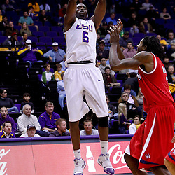 November 30, 2010; Baton Rouge, LA, USA;  LSU Tigers forward Garrett Green (3) shoots over Houston Cougars forward Maurice McNeil (3) during the first half at the Pete Maravich Assembly Center.  Mandatory Credit: Derick E. Hingle