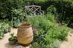 Gravel area with seat and empty urn