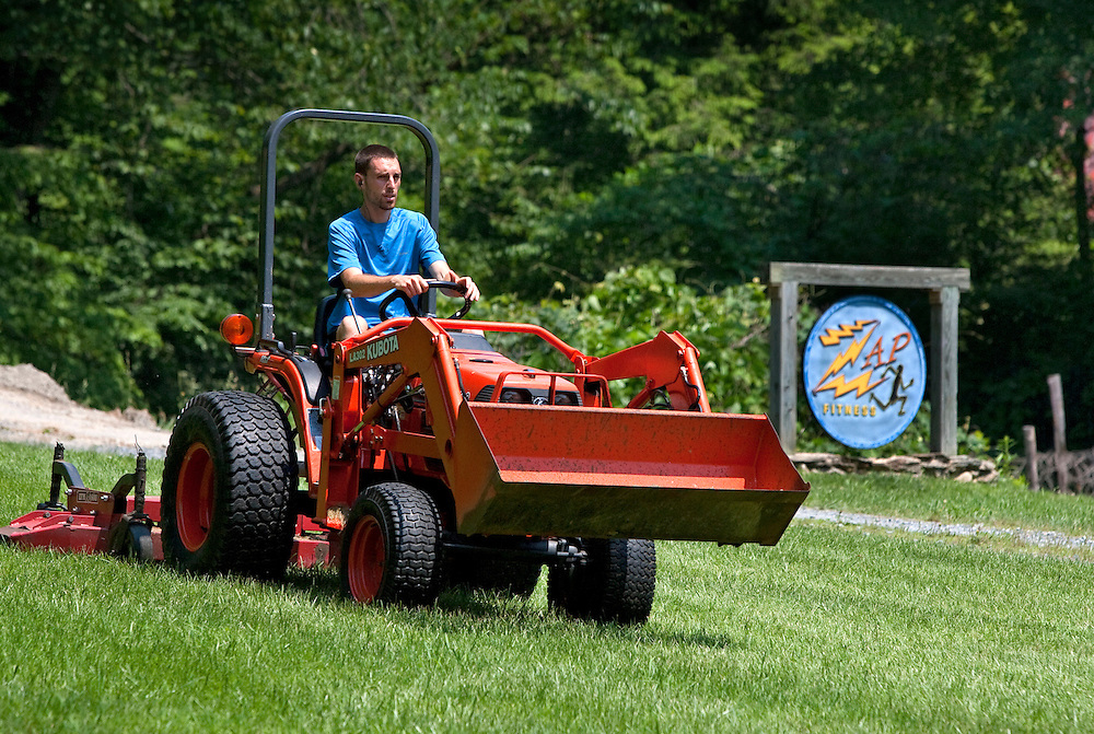 Dave Jankowski mows the yard, one of the required chores for all the athletes at Zap Fitness center in Blowing Rock, NC. .