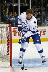 Dec 21, 2011; San Jose, CA, USA; Tampa Bay Lightning left wing Ryan Malone (12) warms up before the game against the San Jose Sharks at HP Pavilion. San Jose defeated Tampa Bay 7-2. Mandatory Credit: Jason O. Watson-US PRESSWIRE