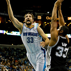 Jan 7, 2013; New Orleans, LA, USA; New Orleans Hornets power forward Ryan Anderson (33) shoots over San Antonio Spurs center Boris Diaw (33) during the third quarter of a game at the New Orleans Arena. The Hornets defeated the Spurs 95-88. Mandatory Credit: Derick E. Hingle-USA TODAY Sports