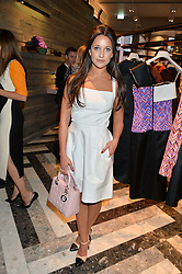 ROXIE NAFOUSI at the opening of Roksanda - the new Mayfair Store for designer Roksanda Ilincic at 9 Mount Street, London on 10th June 2014.