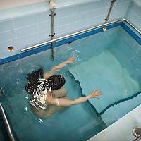 An Ultra Orthodox Jewish woman dips in a Mikve- a jewish ritual bath.