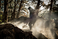 Turning compost at Seresin Estate, a Biodynamic winery on New Zealand's South Island.