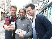 19/05/2014 Nuig Students Mark Naughton and Jack Carey   gets selfie with Luke Ming Flannagan on the streets in Galway . Photo:Andrew Downes