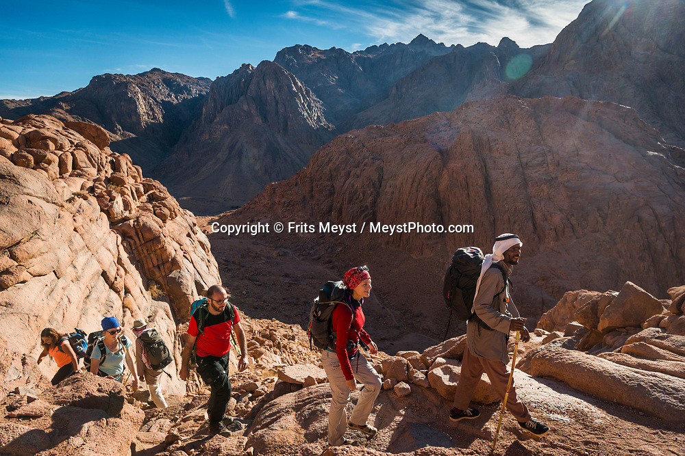 Sinai, Egypt, December 2018.  ascending Mt Sinai through Wadi Shreij with great views on Saint Cathrine Mountain, while hiking with the Jebeleya tribe through the  Saint Catherine Highlands. The Sinai Trail is Egypt's 1st long distance hiking trail, running 230km from the Gulf of Aqaba to the top of the Sinai's highest mountain. It connects old trade, travel and pilgrimage routes through one of the Middle East's most iconic desert wildernesses and is managed by a cooperative of three Bedouin tribes. Photo by Frits Meyst / MeystPhoto.com