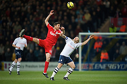 PRESTON, ENGLAND - Saturday, January 3, 2009: Liverpool's Xabi Alonso and Preston North End's Paul McKenna during the FA Cup 3rd Round match at Deepdale. (Photo by David Rawcliffe/Propaganda)