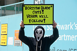 "Protest march against London Fire Brigade cuts.<br />  Protester holds a placard reading ""Boris the blade"" Cuts! Horror will follow!"".<br /> Hundreds of protesters gather in Central London to demonstrate against controversial service cuts to the London Fire Brigade which could see the closure of 10 stations,<br /> London, United Kingdom<br /> Thursday, 18th July 2013<br /> Picture by Piero Cruciatti / i-Images"