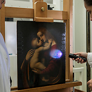 "Milan, Italy, 11 June 2019. The Transparent Restoration laboratory, inside the Pinacoteca di Brera. Paola Borghese, Sofia Incarbone and Ilaria Negri, who together with Andrea Carini constitute the restoration team of the Pinacoteca, are engaged in the observation operation of the painting Madonna with Child by Marco D'Oggiono (painted around 1520). Sofia explains: ""Before proceeding with the restoration of a painting,  it is necessary to perform a series of cognitive investigations. In this case we performed multispectral imaging with photographic and reflectographic techniques (in visible light, visible grazing, infrared and ultraviolet, ) that allow us to gain some information about the production technique and the conservation history of the work, which will be   integrated with the historical information that we already know. At this point we did some cleaning tests to find a suitable method to thin out the present paint surface -  not original one, which is  now yellowed and opaque. The cleaning operation serves to attenuate the visual disturbance created by the yellowed paint and enables us to restore as much as possible the correct chromatic relationships in respect of the original material, taking into account the conservation history of the work and its state of preservation "".<br /> 
