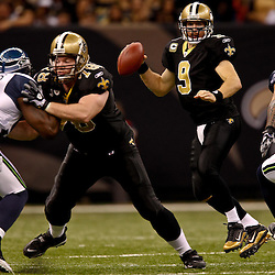 November 21, 2010; New Orleans, LA, USA; New Orleans Saints quarterback Drew Brees (9) is pressured by Seattle Seahawks linebacker Lofa Tatupu (51) during the second half at the Louisiana Superdome. The Saints defeated the Seahawks 34-19. Mandatory Credit: Derick E. Hingle