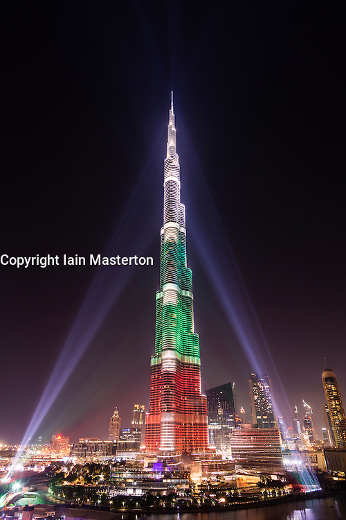 Burj Khalifa Tower floodlit in the white, green and red colours of the flag of the United Arab Emirates (UAE) to celebrate the 42nd National Day of the UAE