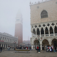 VENICE, ITALY - NOVEMBER 19:  A general view of St Mark's Square with the belfry and Palazzo Ducale as thick fog shrouds the city, on November 19, 2011 in Venice, Italy. Venice woke up this morning under a heavy blanket of fog adding to the atmoshere of the city. HOW TO LICENCE THIS PICTURE: please contact us via e-mail at sales@xianpix.com or call our offices London   +44 (0)207 1939846 for prices and terms of copyright. First Use Only ,Editorial Use Only, All repros payable, No Archiving.© MARCO SECCHI