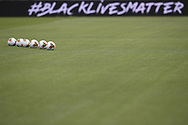Matchballs lines up on the field of play with a black lives matter advert visible on the led hoardings during the Serie A match at Stadio Grande Torino, Turin. Picture date: 20th June 2020. Picture credit should read: Jonathan Moscrop/Sportimage