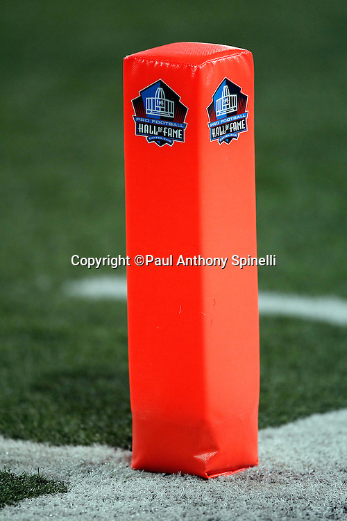 An end zone pylon with the Hall of Fame logo sits on the field during the NFL Pro Football Hall of Fame preseason football game between the Dallas Cowboys and the Cincinnati Bengals on Sunday, August 8, 2010 in Canton, Ohio. The Cowboys won the game 16-7. (©Paul Anthony Spinelli)