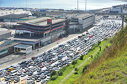 © Licensed to London News Pictures. 24/07/2016<br /> The Dover traffic hell continues today (24.07.2016) in Kent.<br /> Long queues at the Port of Dover this afternoon<br />  because of very long delays at French border control. <br /> (Byline:Grant Falvey/LNP)