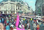 Ravers marching with Liberty Flag through Piccadilly Circus against the First Criminal Justice Act.London. 1st of May 1994.