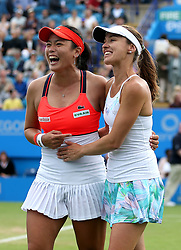 Chinese Taipei's Yung-jan Chan (left) and Switzerland's Martina Hingis (right) celebrate winning against Australia's Ashley Barty and Casey Dellacqua in the Women's Doubles Final during day nine of the AEGON International at Devonshire Park, Eastbourne.