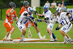 Duke midfielder Michael Ward (9) scoops up a loose ball against UVA.  The #2 ranked Duke Blue Devils defeated the #3 ranked Virginia Cavaliers 11-9 in the finals of the Men's 2008 Atlantic Coast Conference tournament at the University of Virginia's Klockner Stadium in Charlottesville, VA on April 27, 2008.